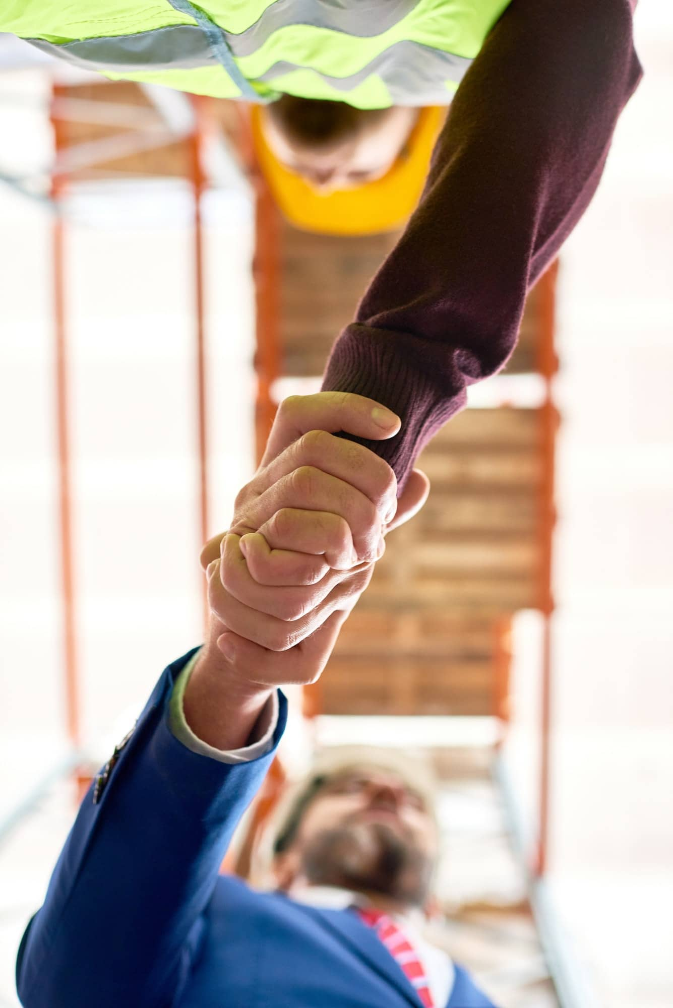 Businessman Shaking Hands with Worker