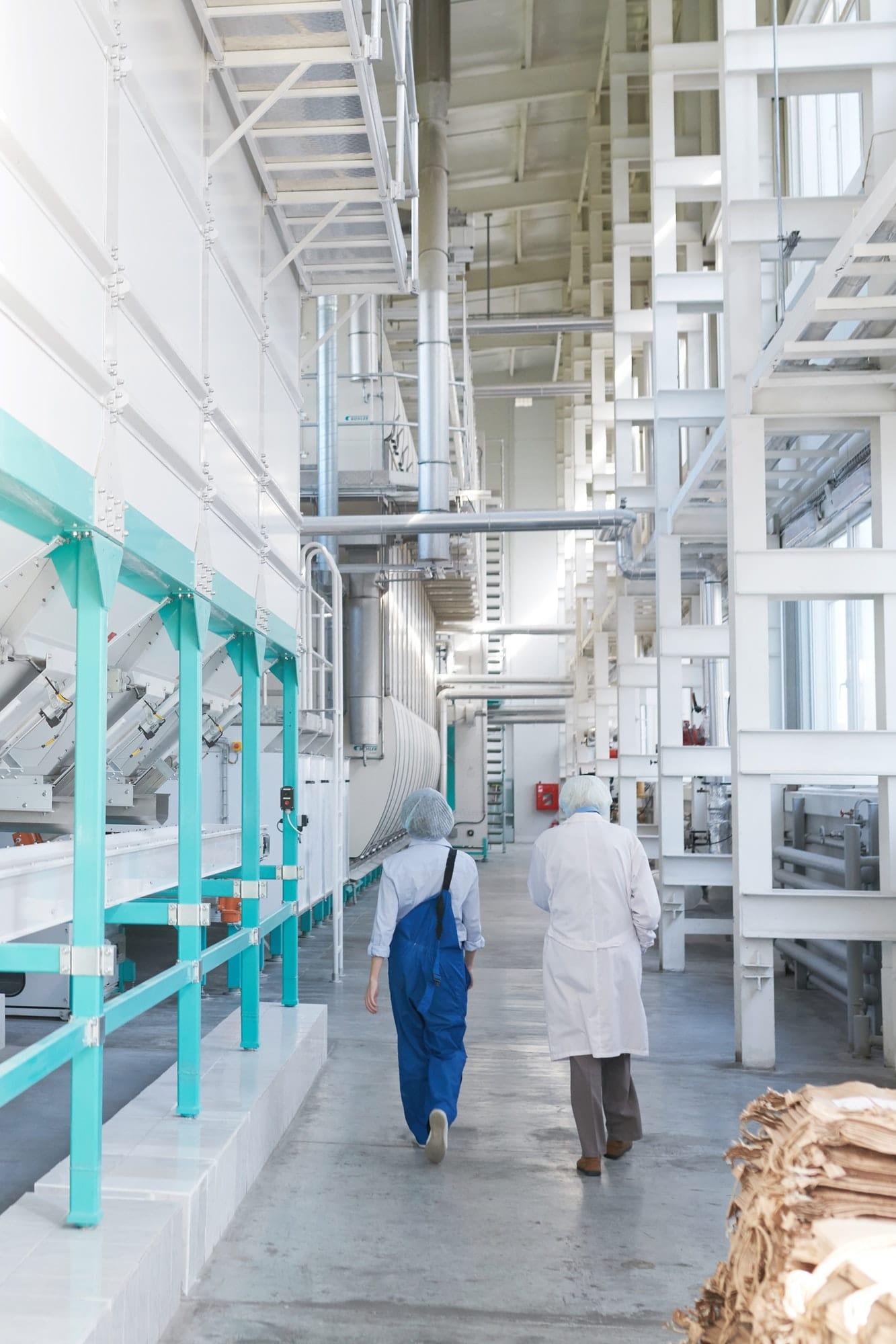 Workers Crossing Modern Workshop